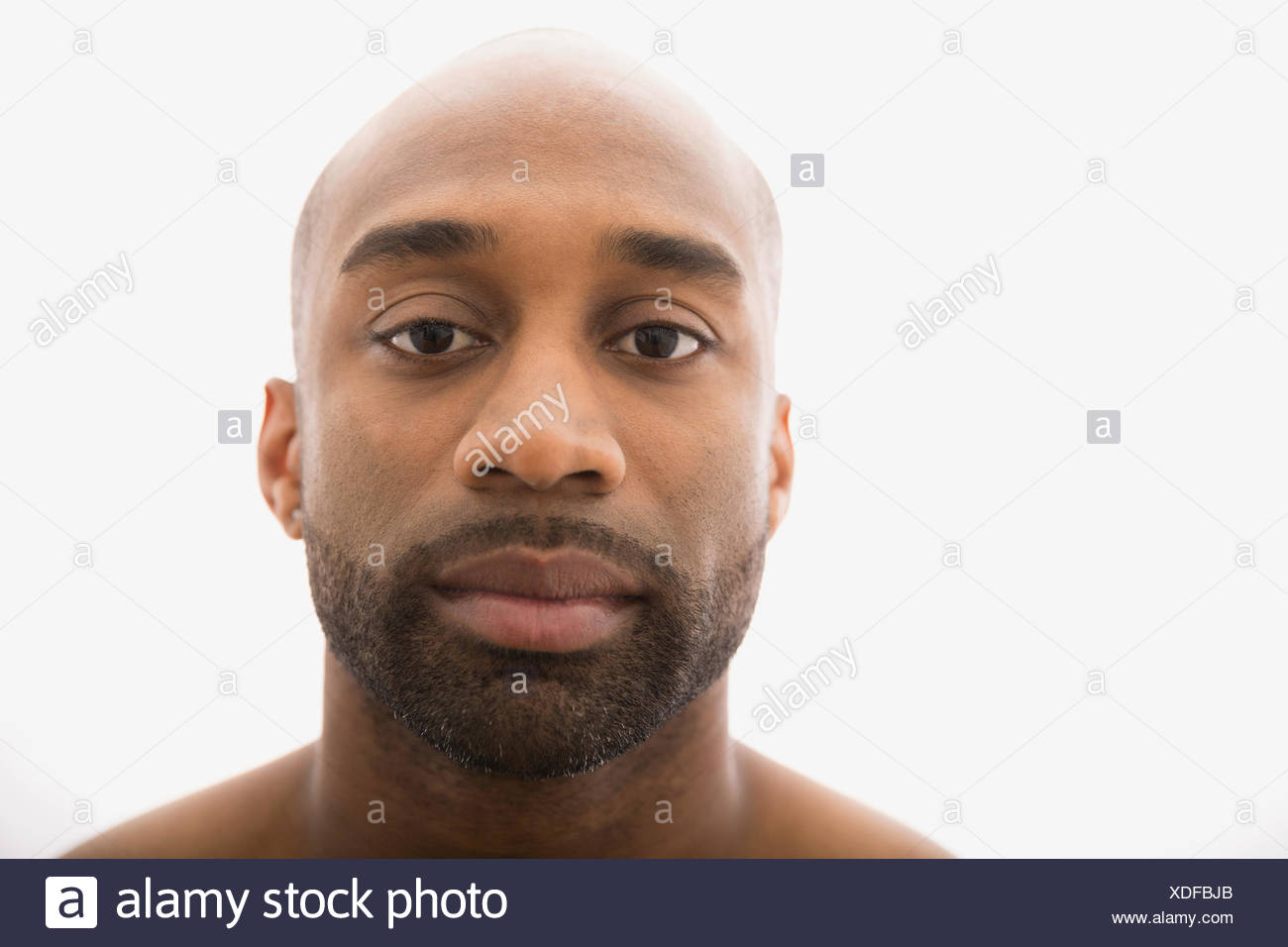Close up portrait of serious man with beard - Stock Image