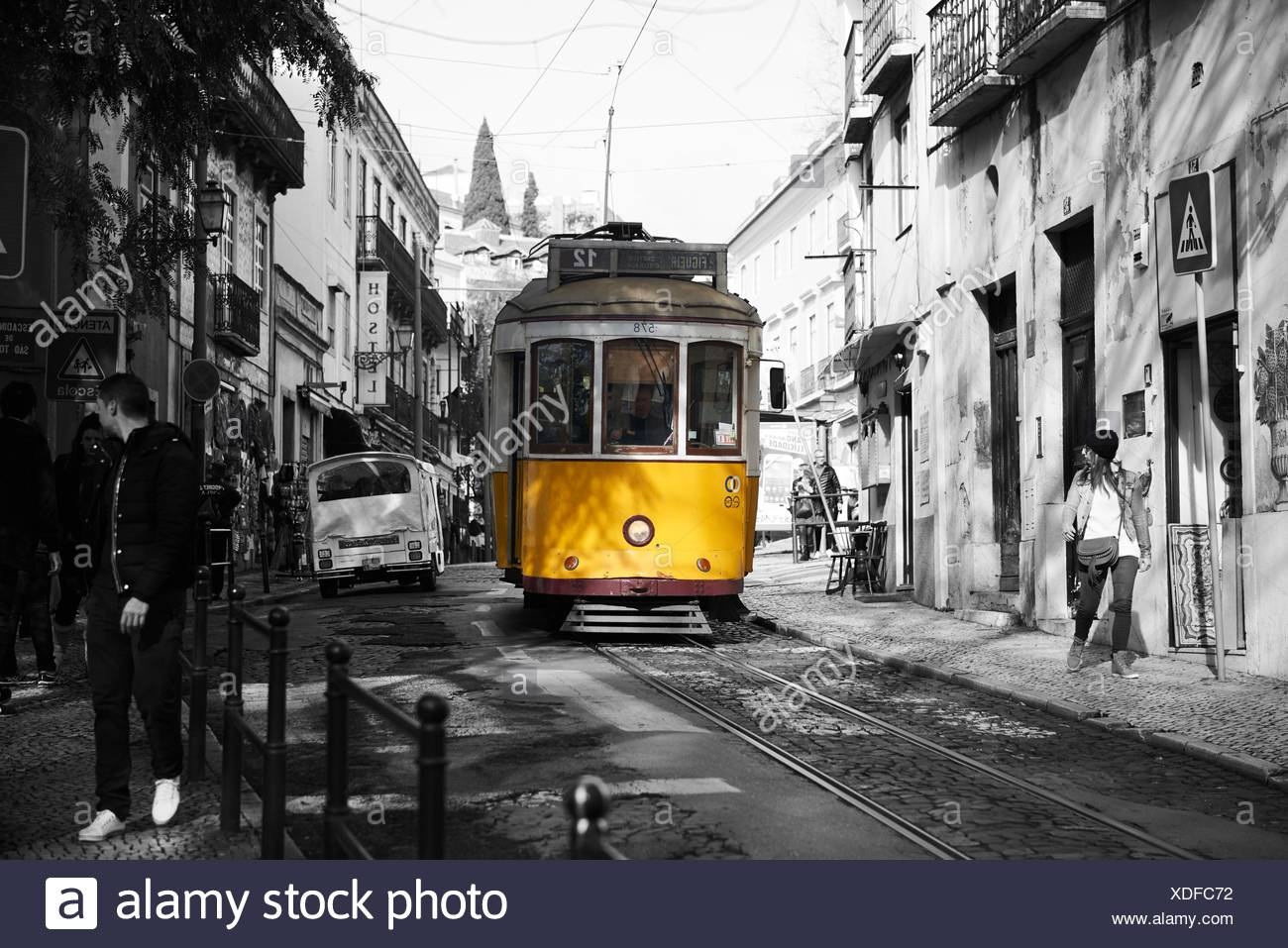 Photograph in black and white mixed with colour of Yellow Tram in Lisbon, Portugal, Europe - Stock Image