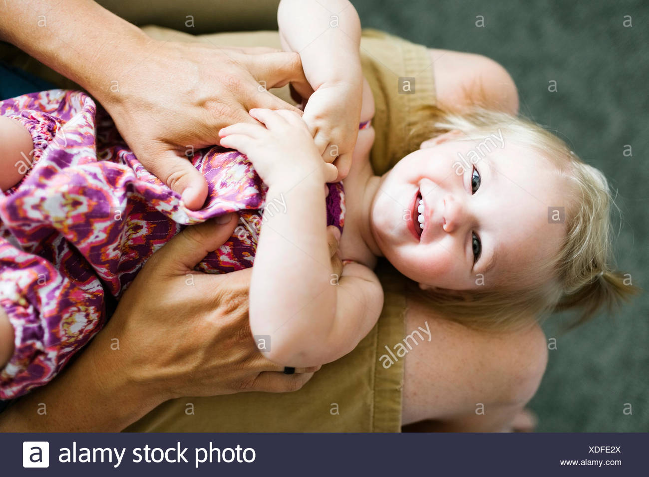 Father playing with baby girl (12-17 months) - Stock Image