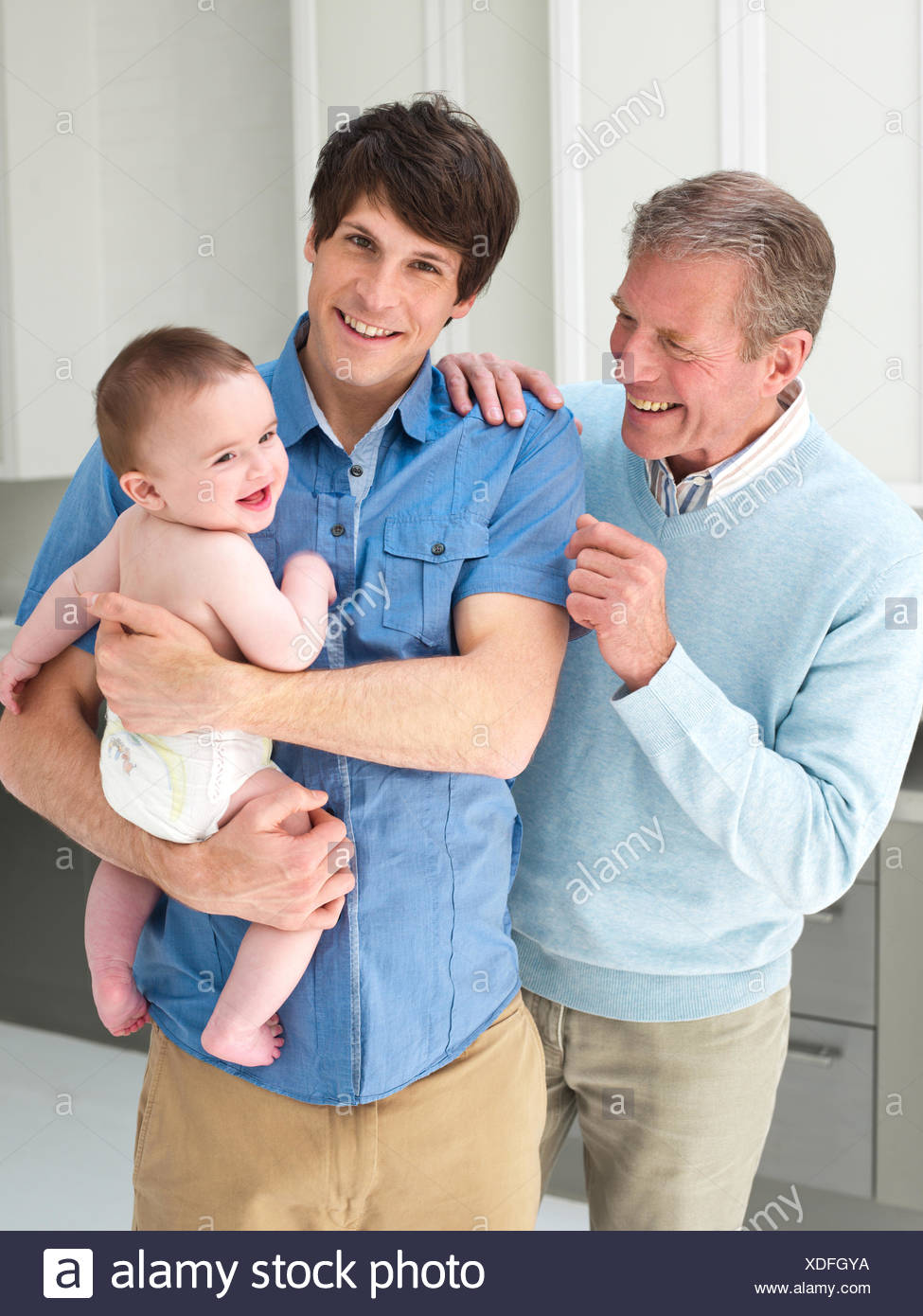 Smiling multi-generation males - Stock Image