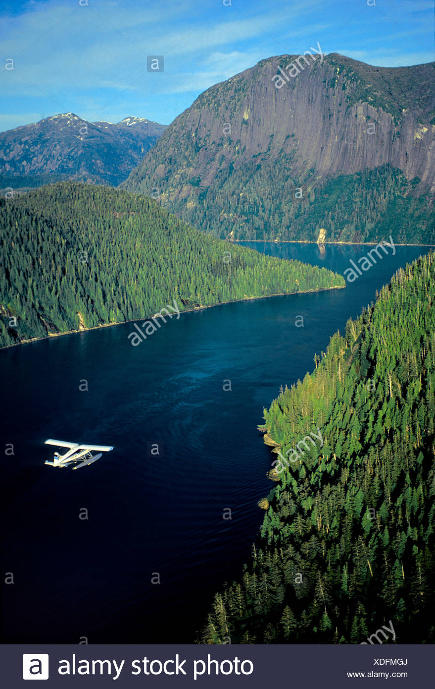 Aerial view of float plane flying over Misty Fjords' *Punchbowl* in Southeast Alaska during Summer - Stock Image