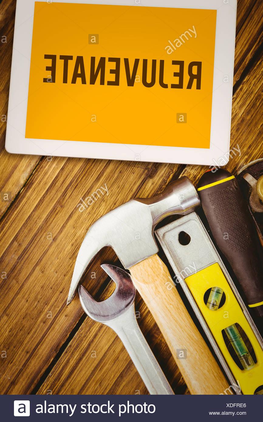 Rejuvenate  against desk with tools - Stock Image