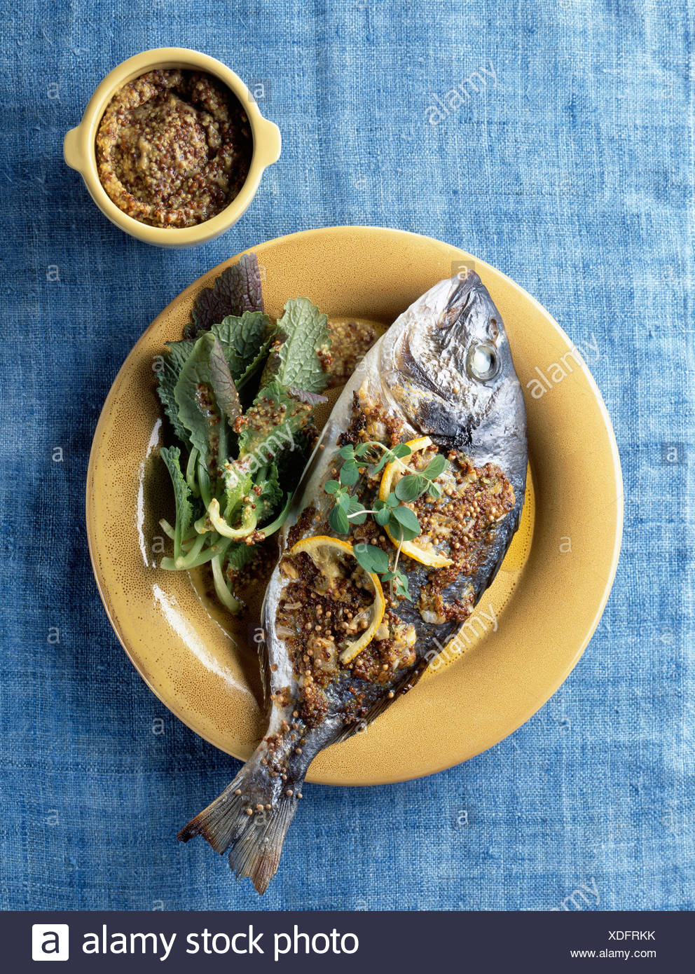 Sea bream baked in traditional grained mustard - Stock Image