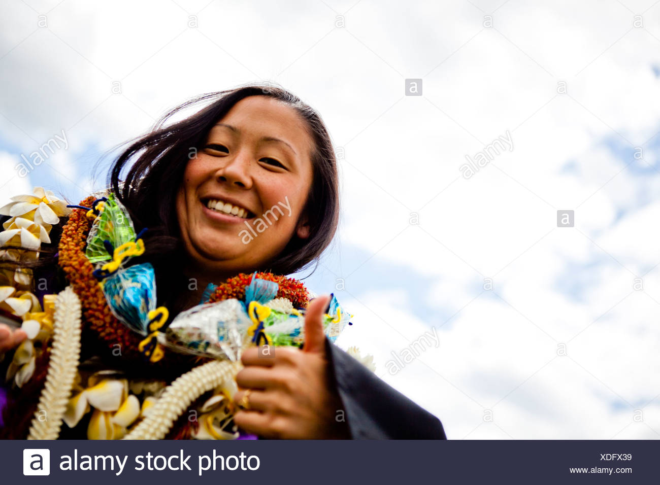 a graduate is shrouded in Hawaiian Leis (lays) on her graduation day from the University of New Haven. - Stock Image