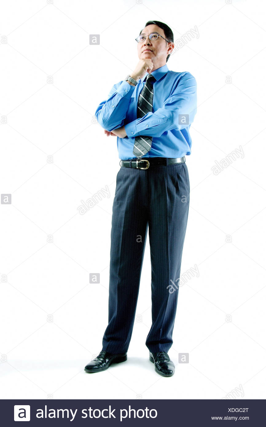 Businessman Standing Arms Crossed Hand On Chin Stock Photo