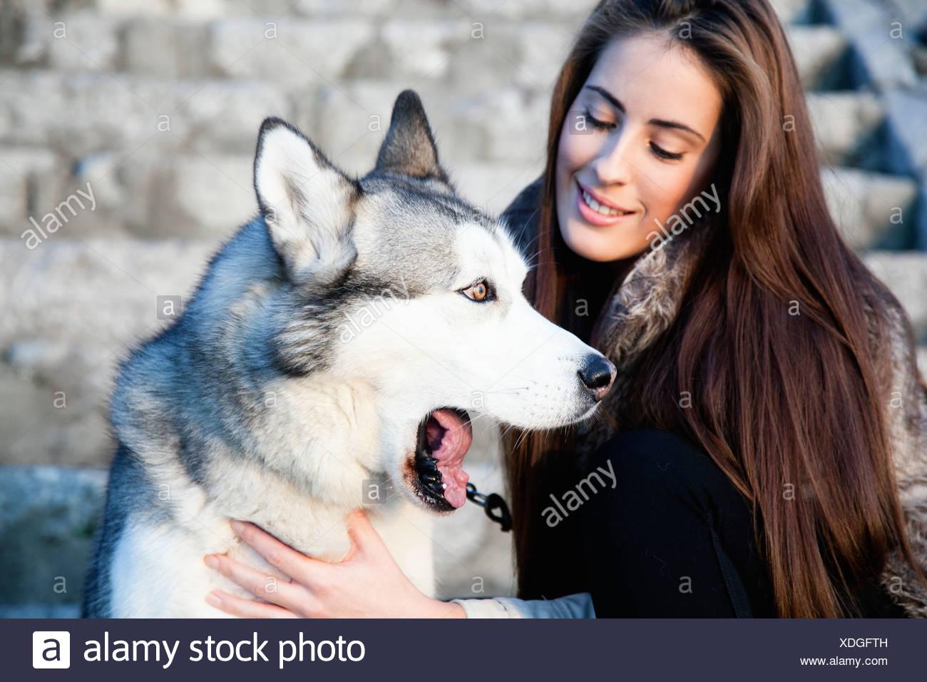 Woman with Dog Outdoors, Croatia - Stock Image