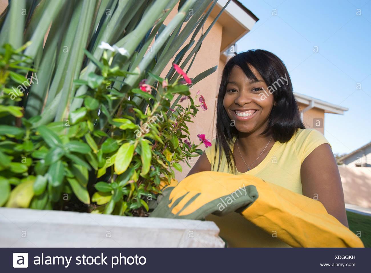 Woman tending plants - Stock Image