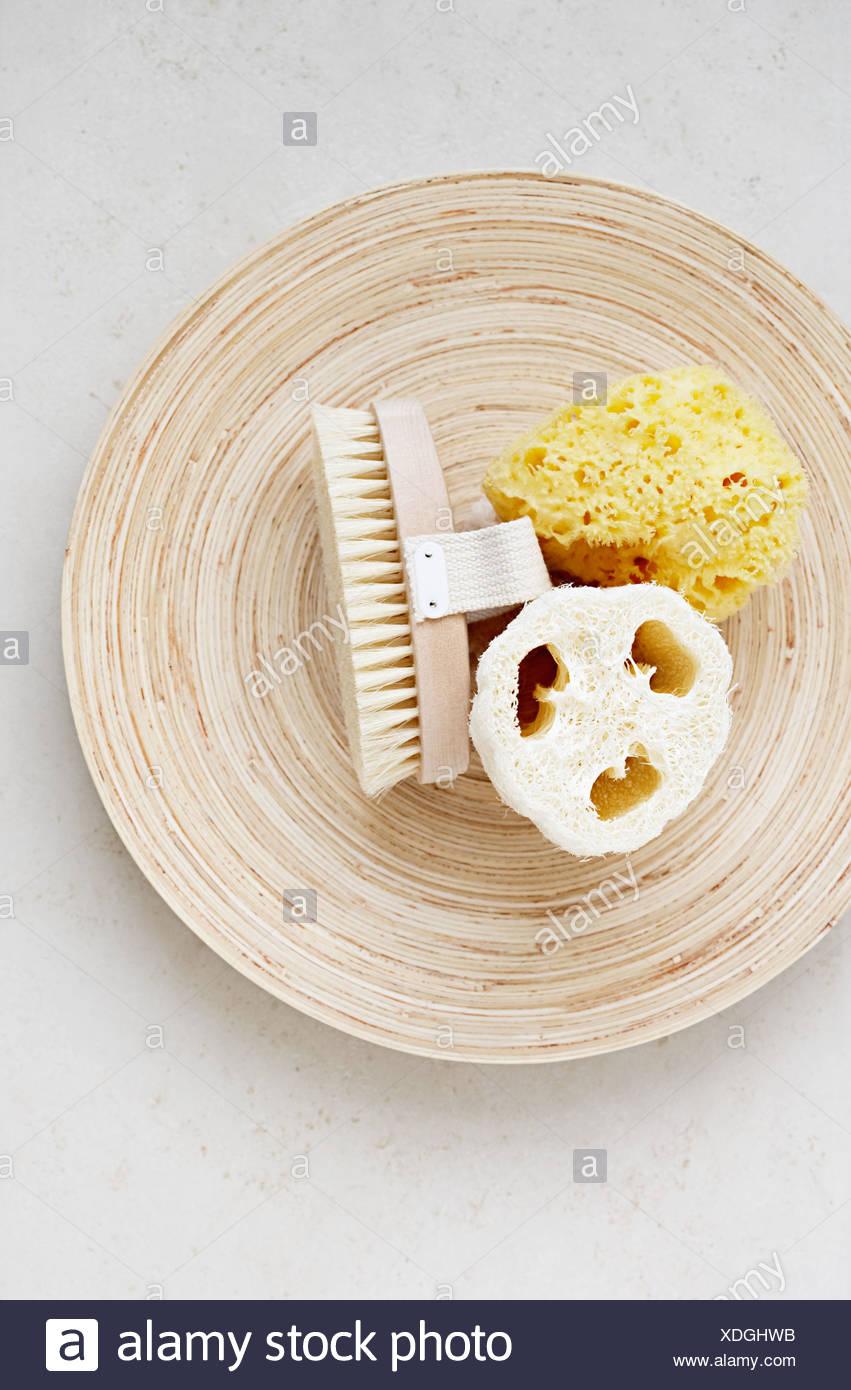 Massage brush loofah and sponge on a dish Stock Photo