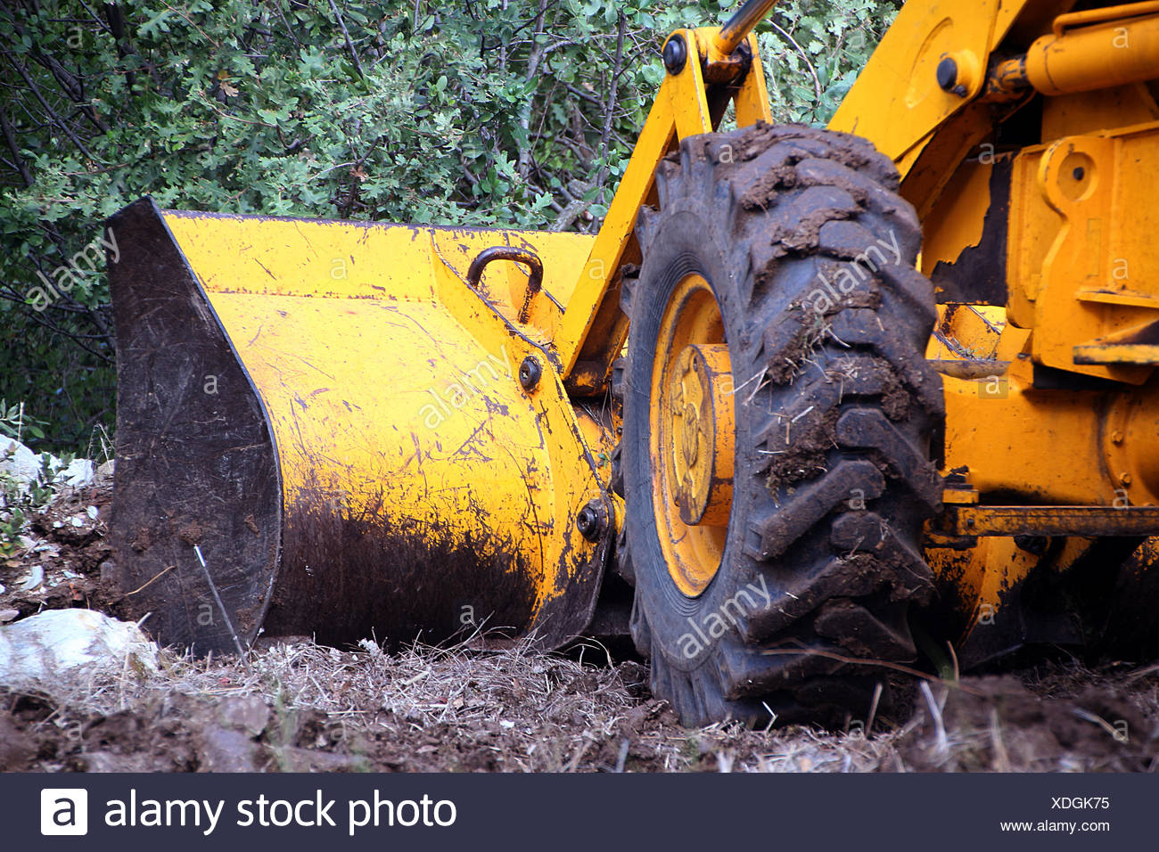 Mechanical digger excavating soil - Stock Image
