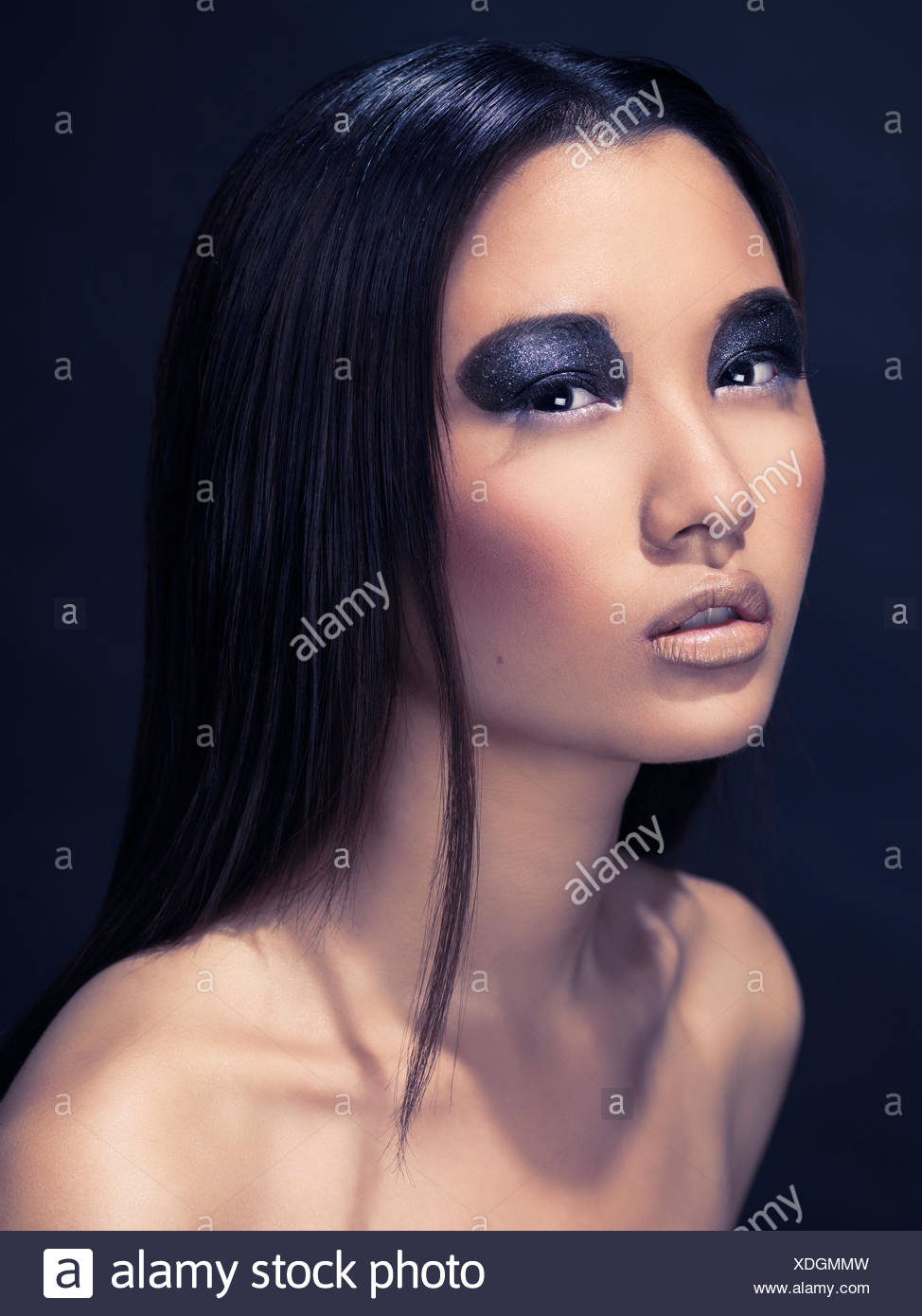 Woman wearing dark eyeshadow - Stock Image