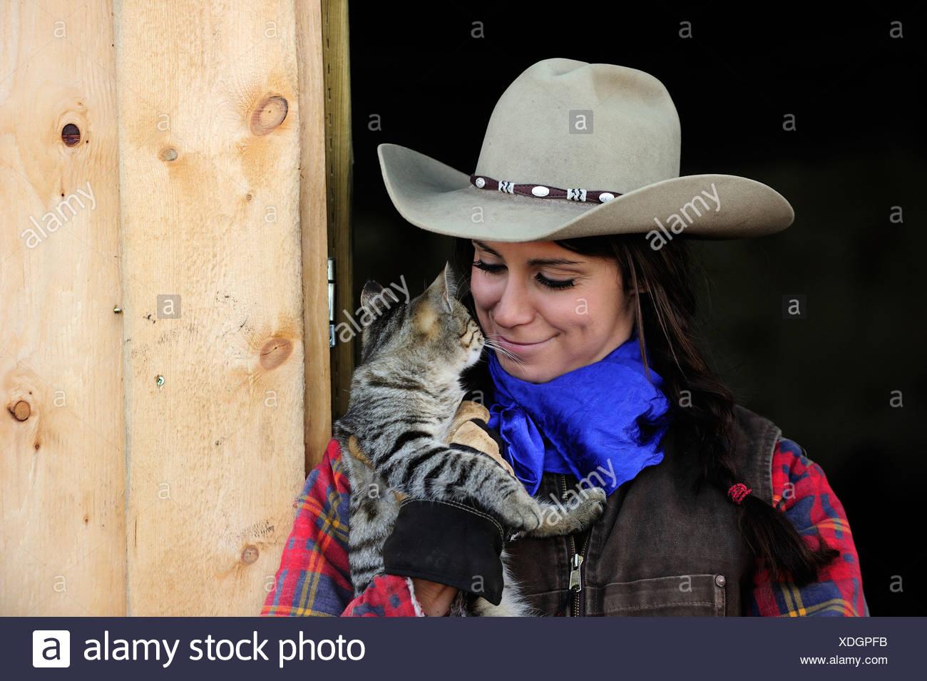 Cowgirl with cat, portrait, Saskatchewan, Canada, North America ...