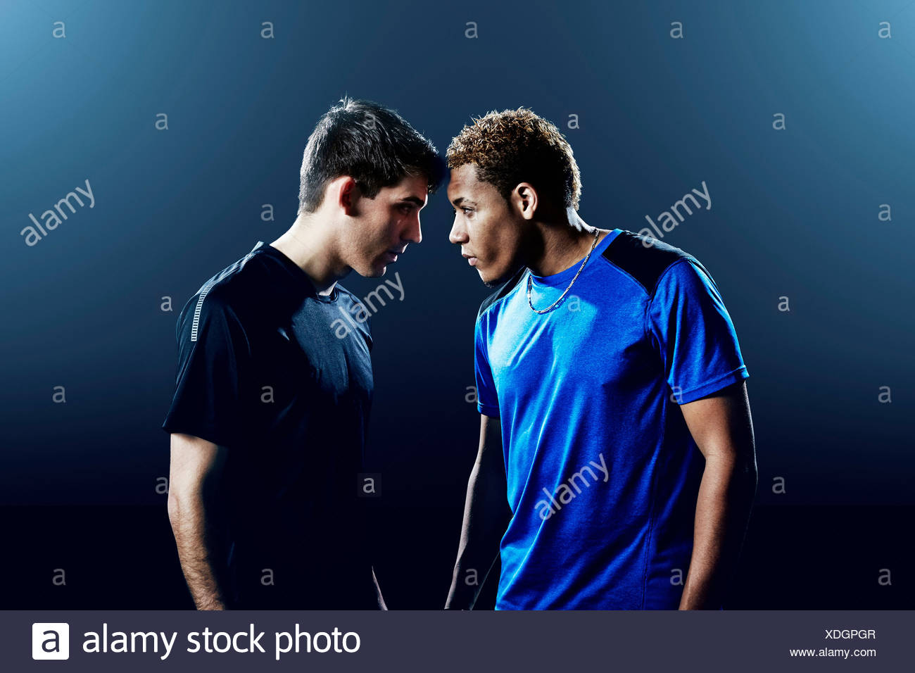 Portrait of two male soccer players head to head - Stock Image