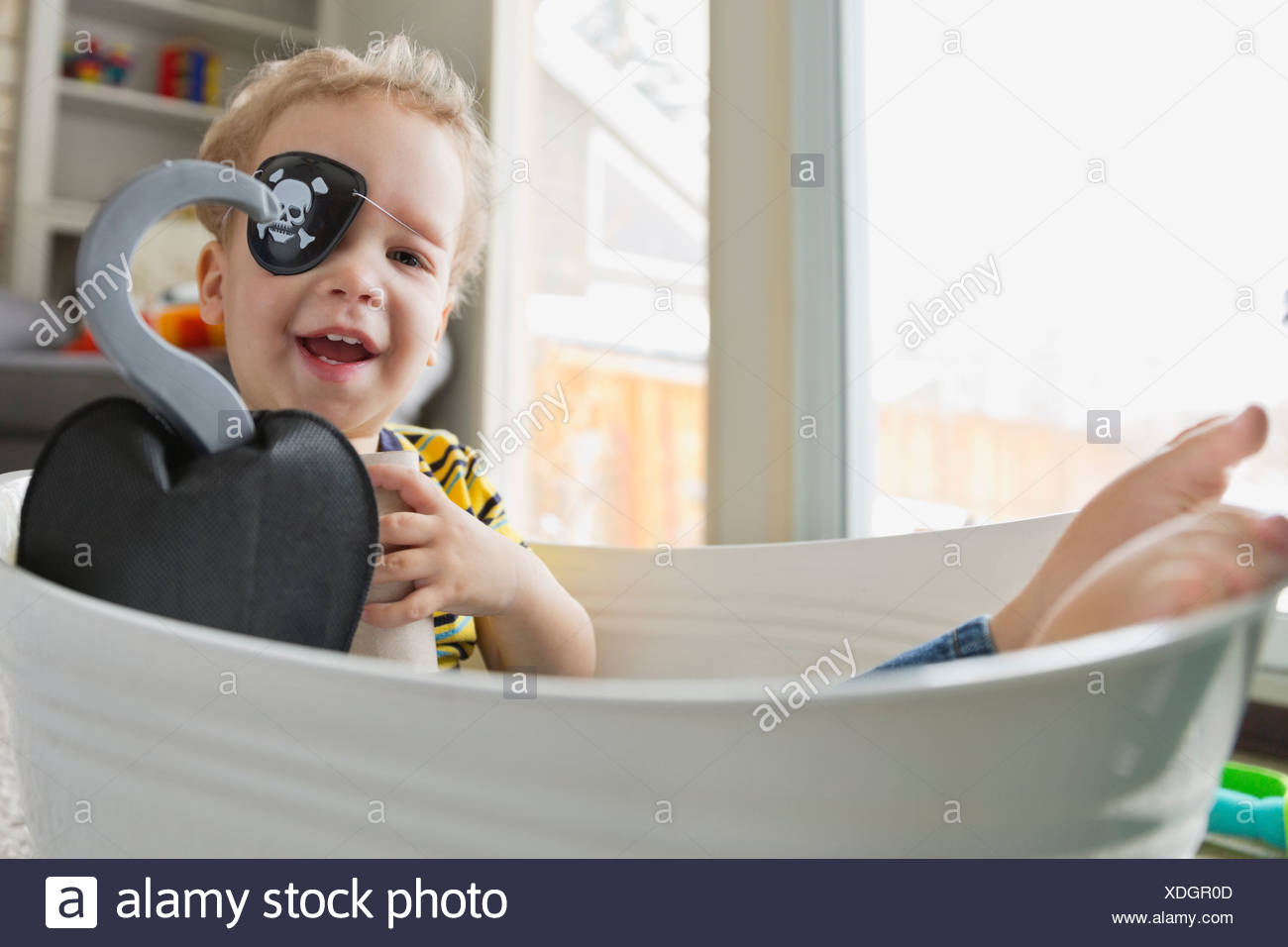 Portrait of little boy dressed as pirate - Stock Image