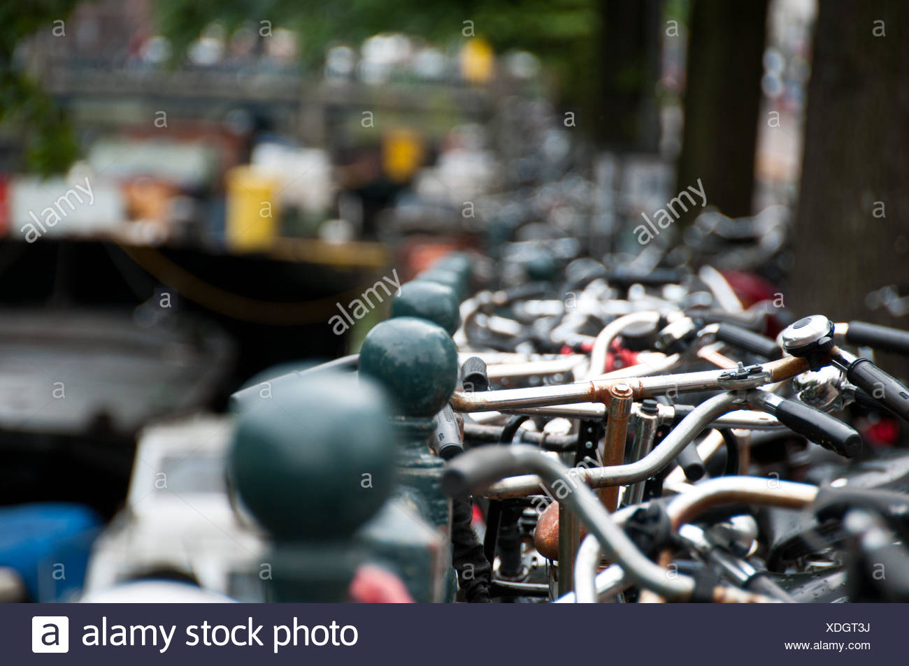 Close-Up Bicycle Handlebars In A Row - Stock Image