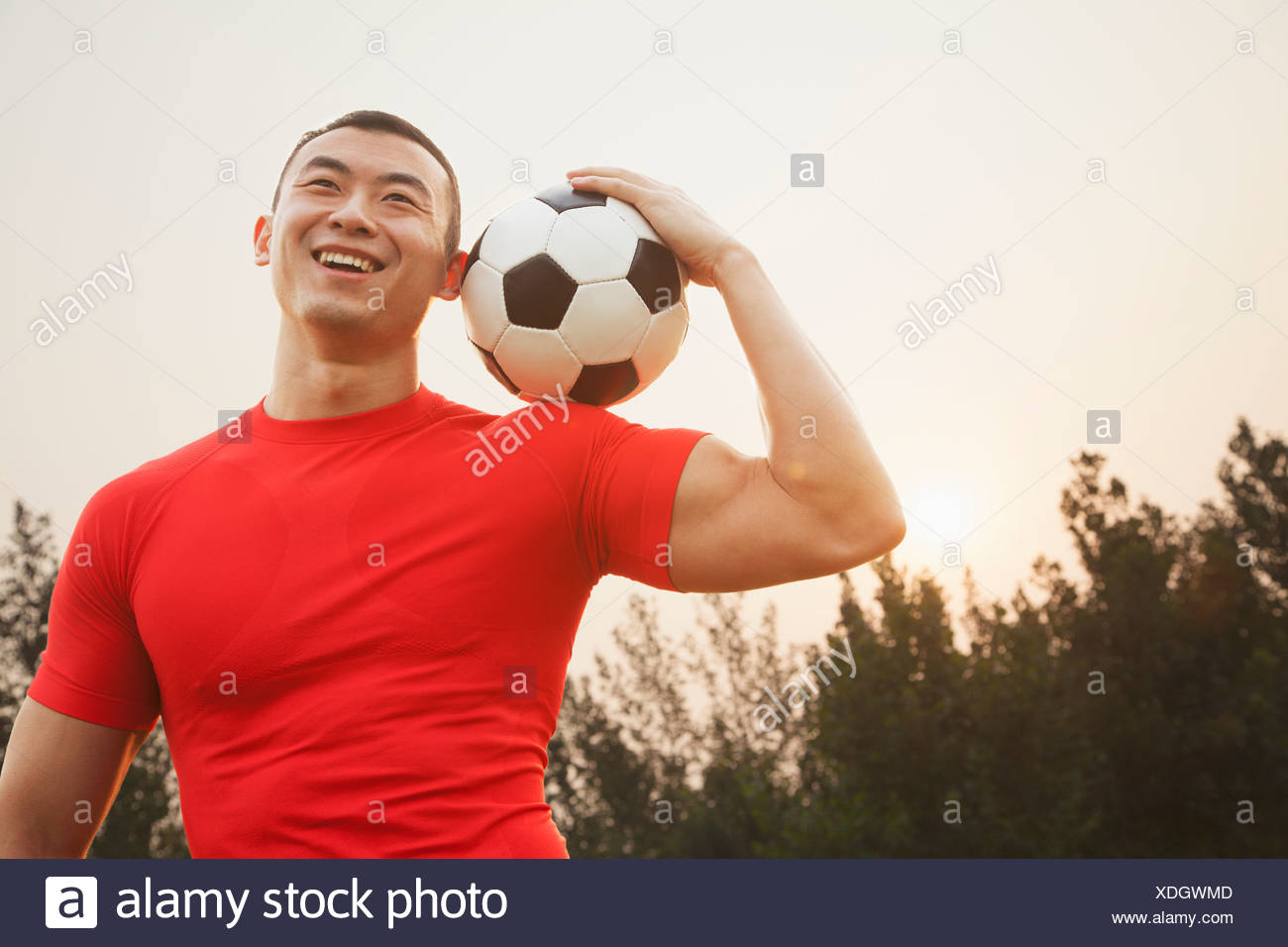 Athletic Man with Soccer Ball - Stock Image