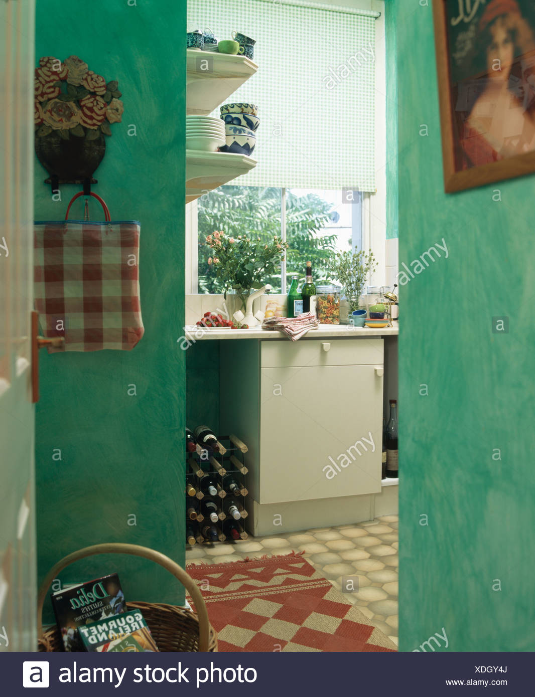 Traditional green kitchen with red checked rug on floor and ...