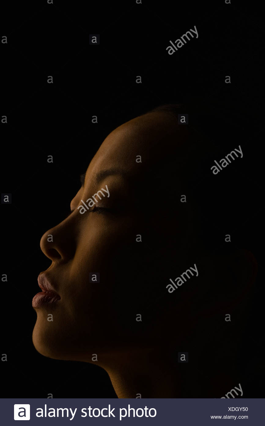 Woman witn eyes closed, profile - Stock Image