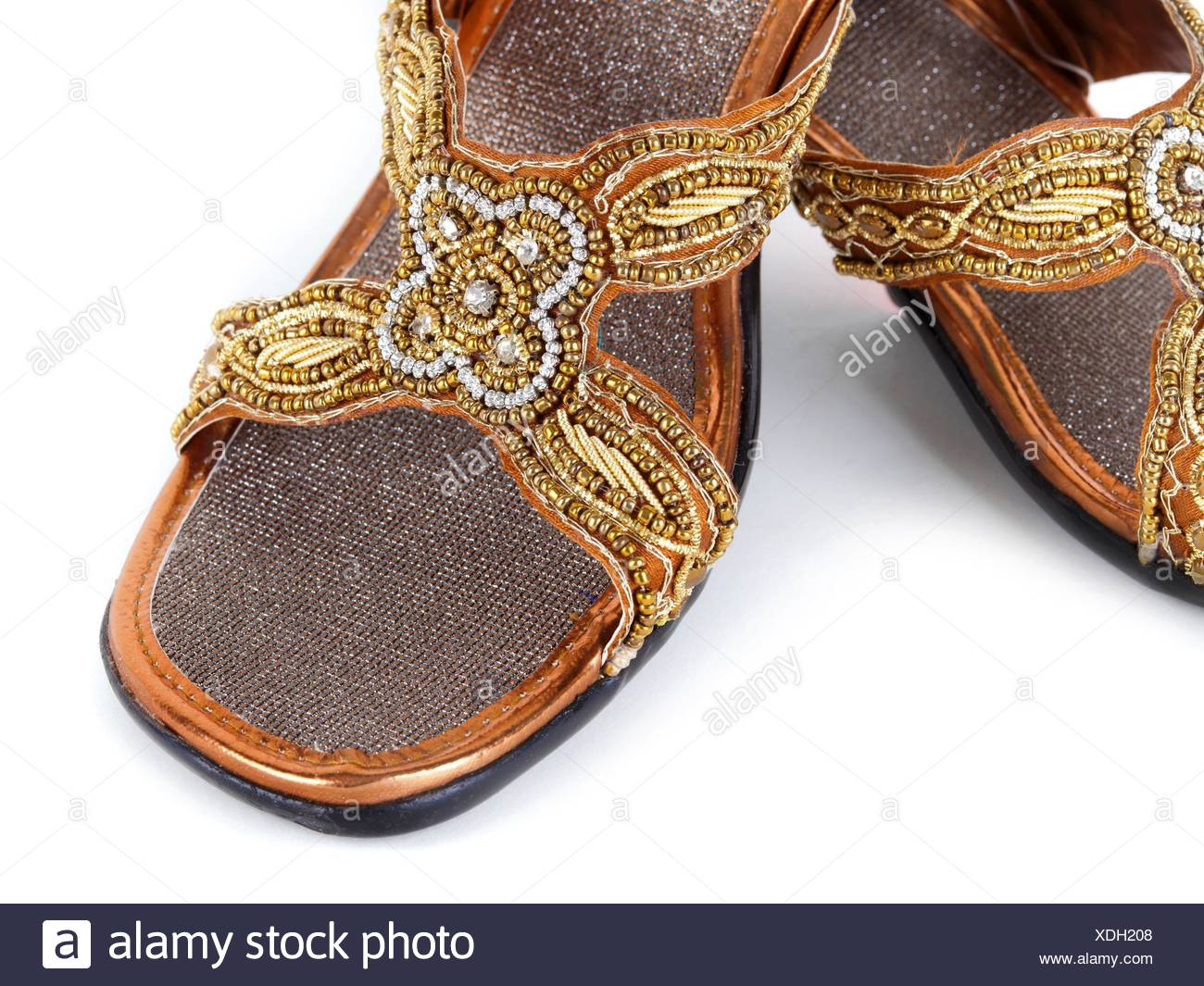 8aff5215cb4c3 Pair of traditional Indian sandals on white background. - Stock Image