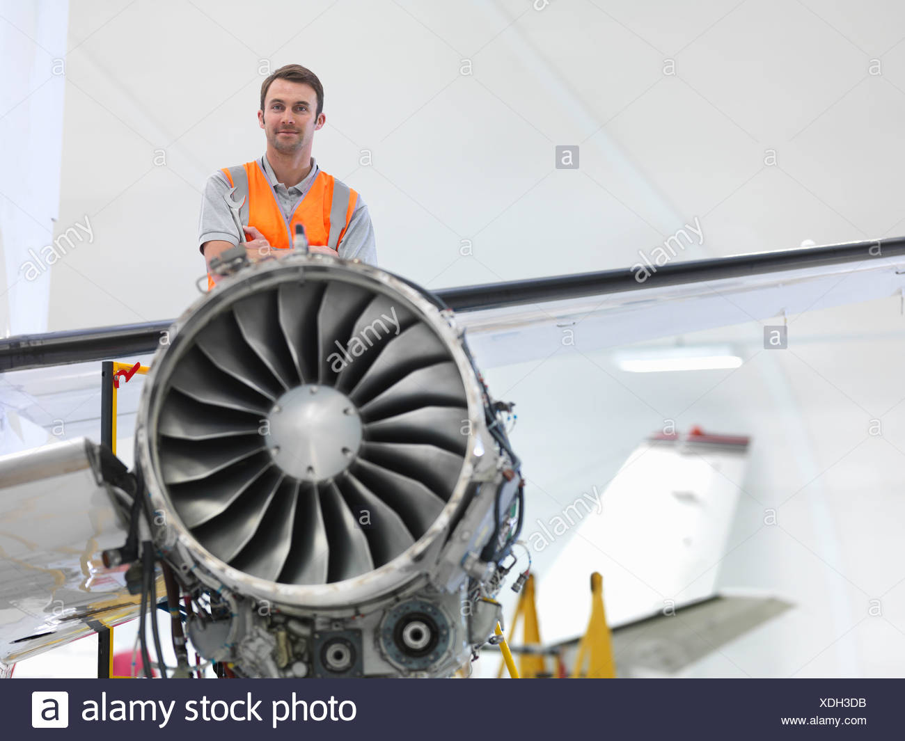 Engineer with jet engine - Stock Image