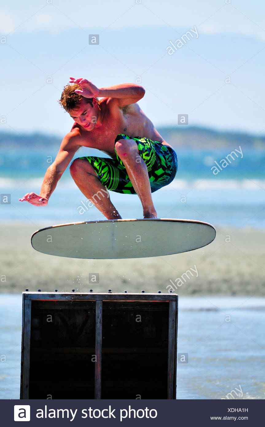 Skimboarder  gets some air jump during 2010 - Stock Image