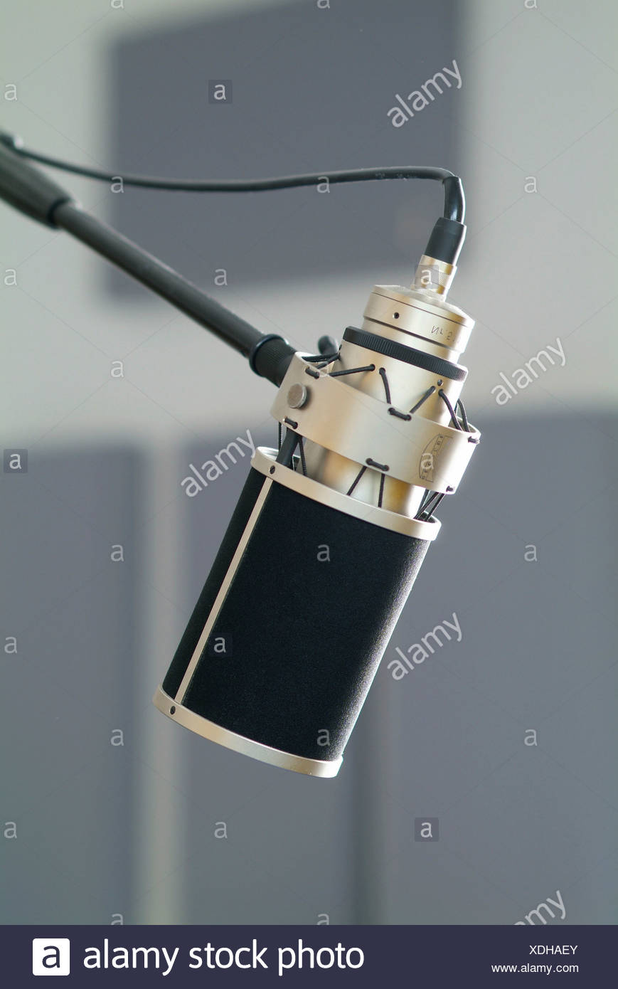 Professional studio microphone in a recording studio - Stock Image