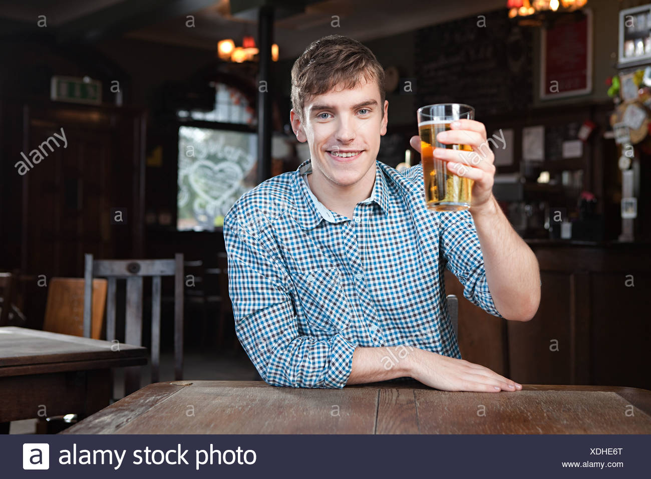 Young man in bar - Stock Image