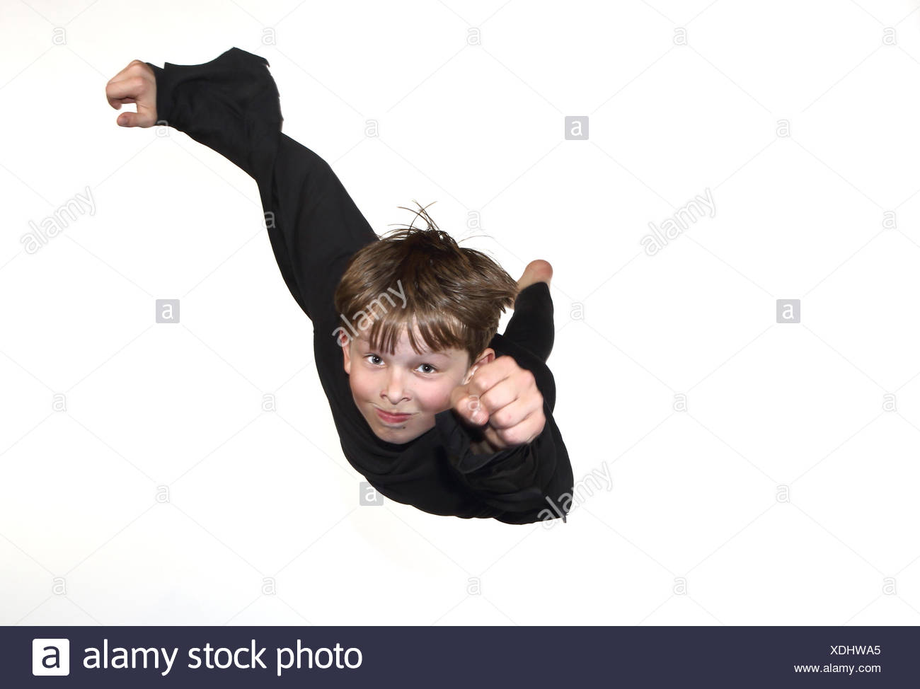 Berlin, Germany, boy appears to float in Superman-style through the air - Stock Image