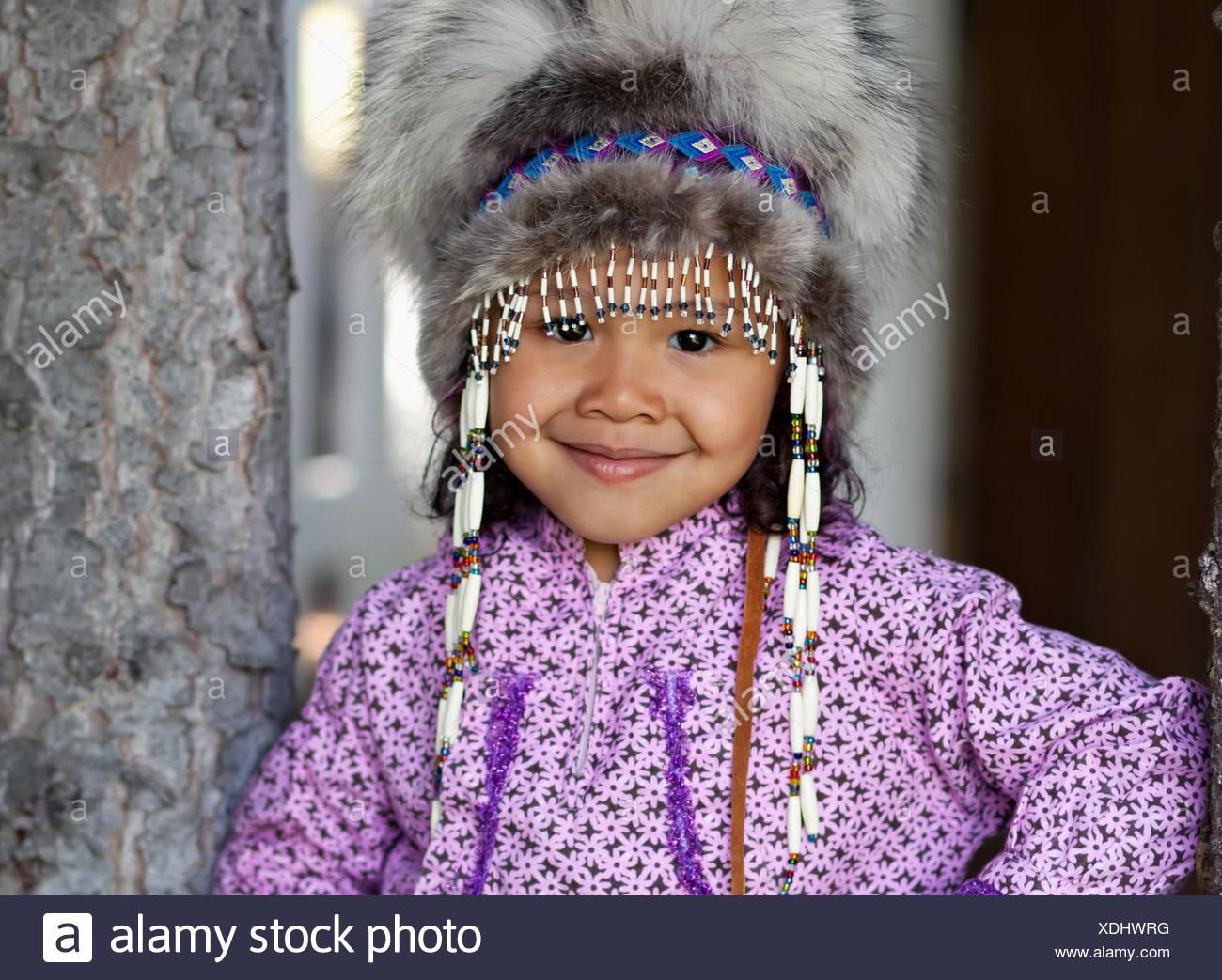 Eskimo Girl Wearing An Alaskan Native Headdress And Kuspuk In Eagle River, Southcentral Alaska In Summer. - Stock Image