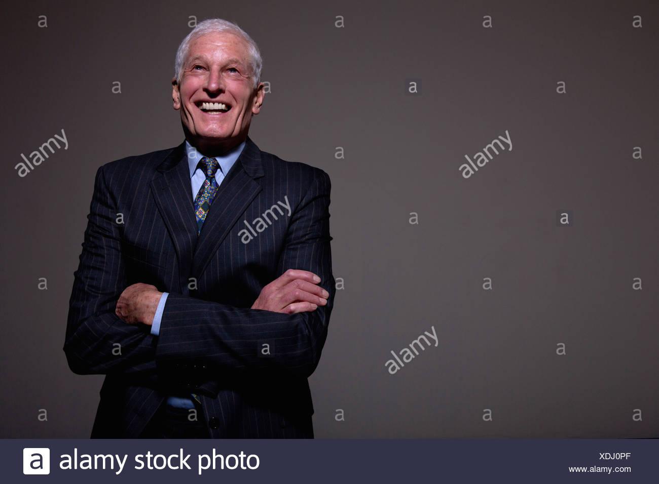 Studio portrait of senior man in suit - Stock Image