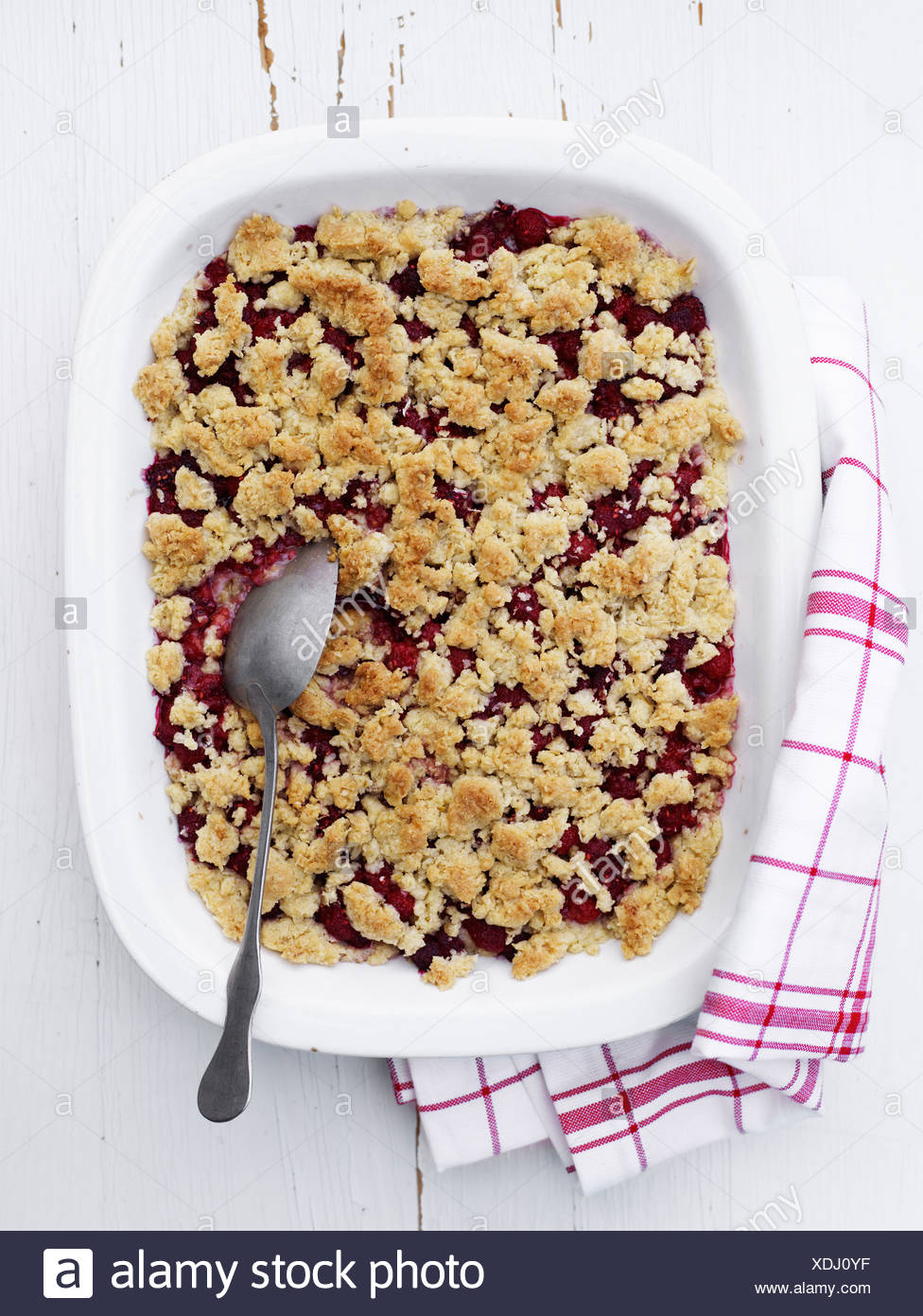 Scandinavia, Sweden, Raspberry pie in bowl, close-up - Stock Image