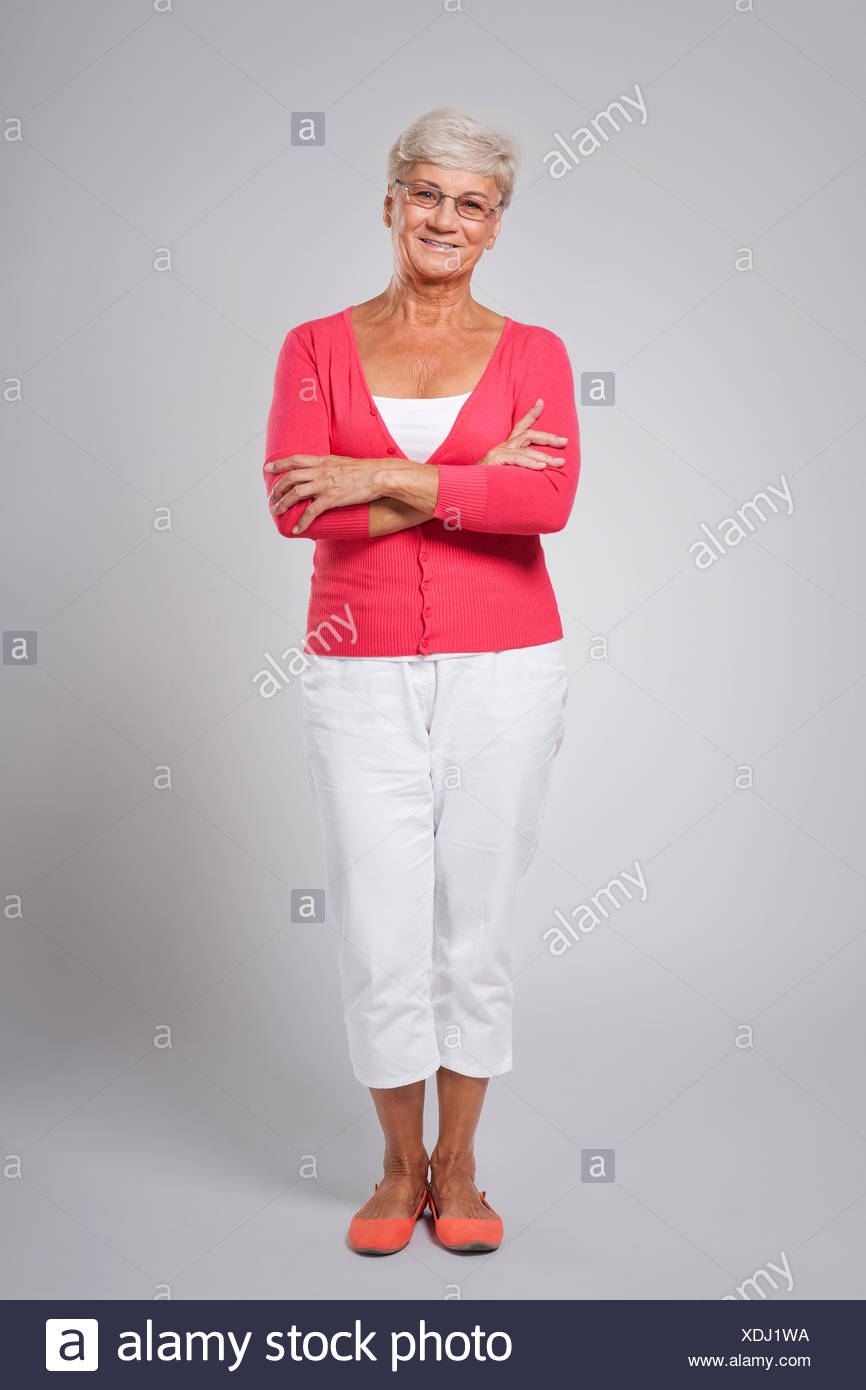 Lady in red shirt and white pants - Stock Image