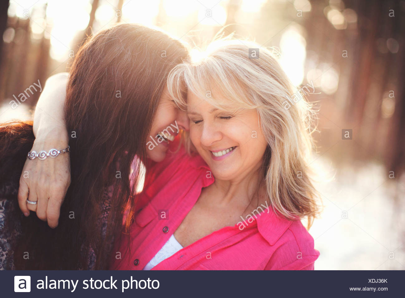 Close up portrait of mature women in forest - Stock Image