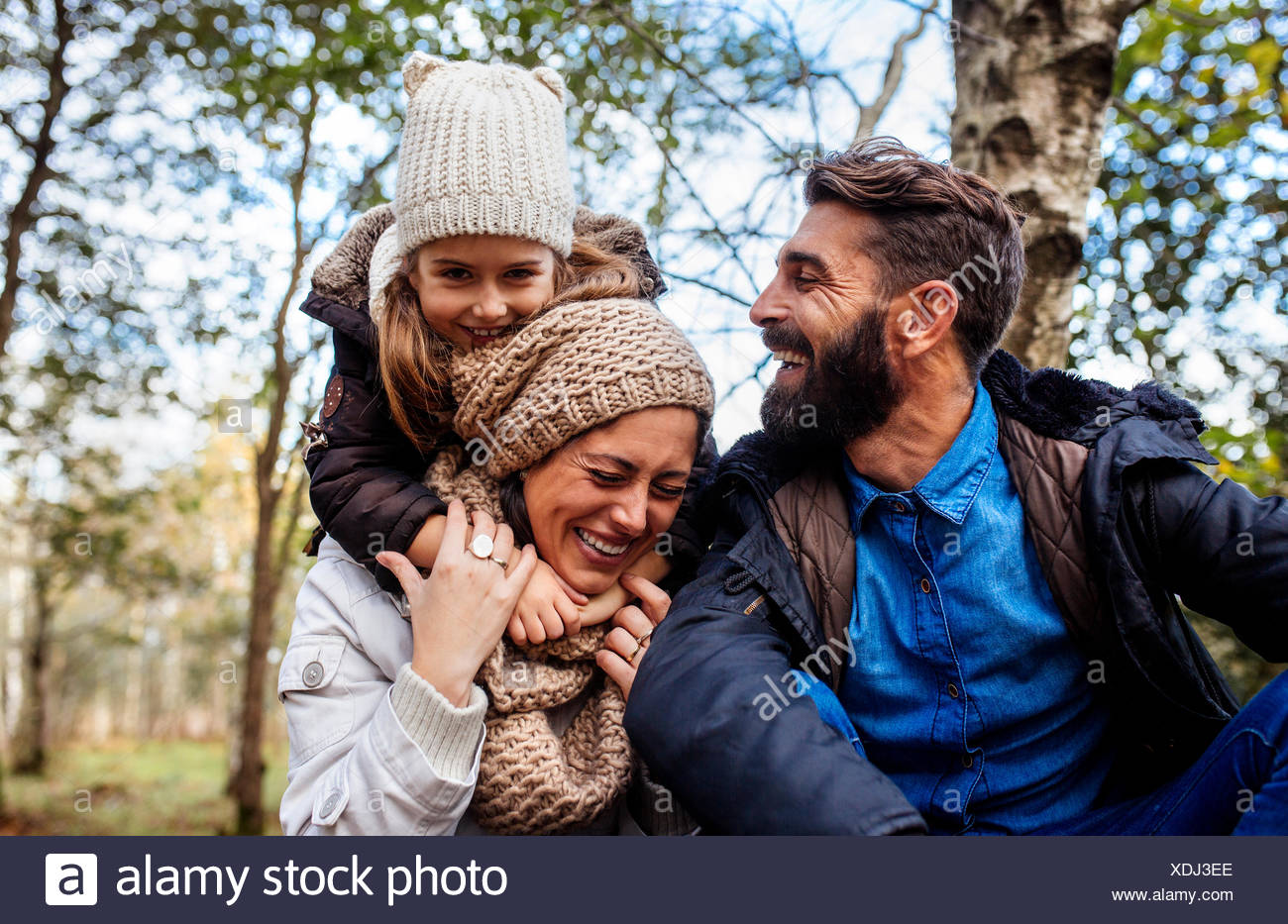 Happy parents with daughter in the forest - Stock Image