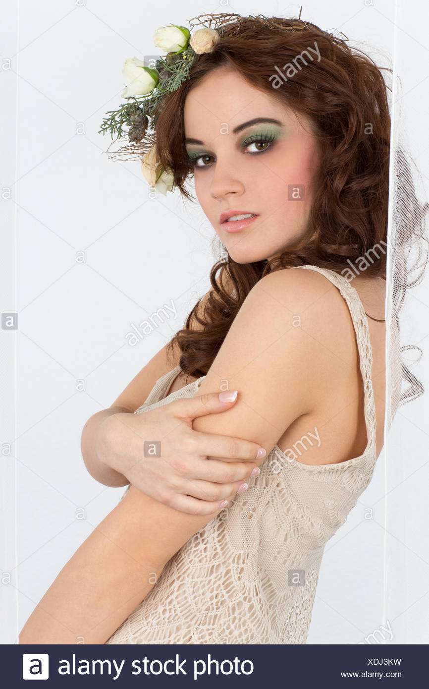 Young woman with flower arrangement as a headdress Stock Photo