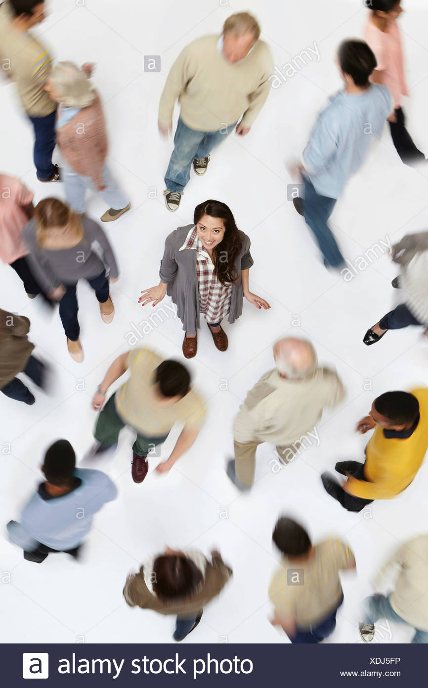 Woman standing in crowd of people, high angle view - Stock Image