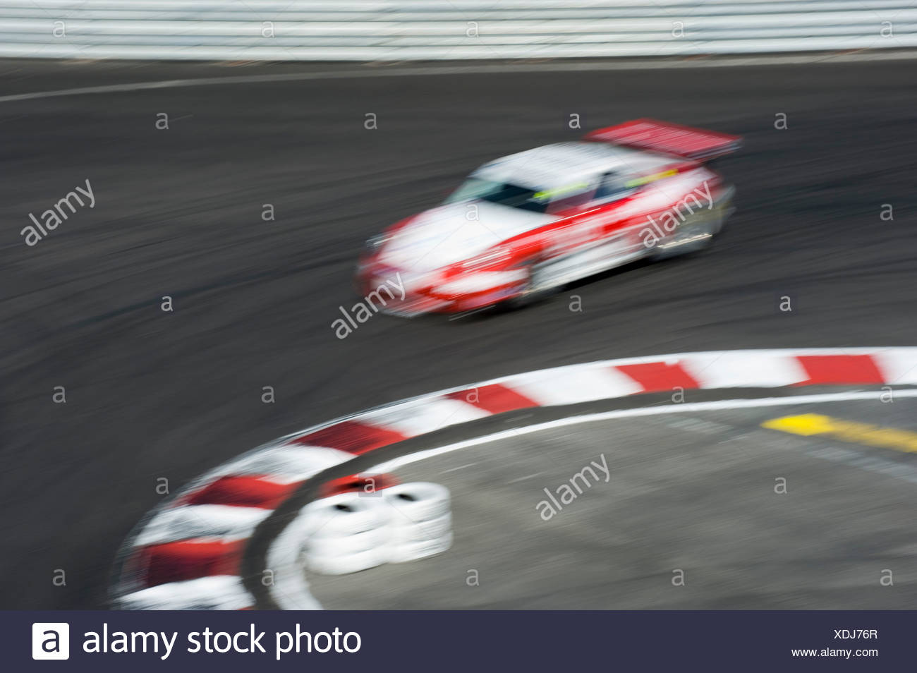 Motion blur of car race by the curve - Stock Image