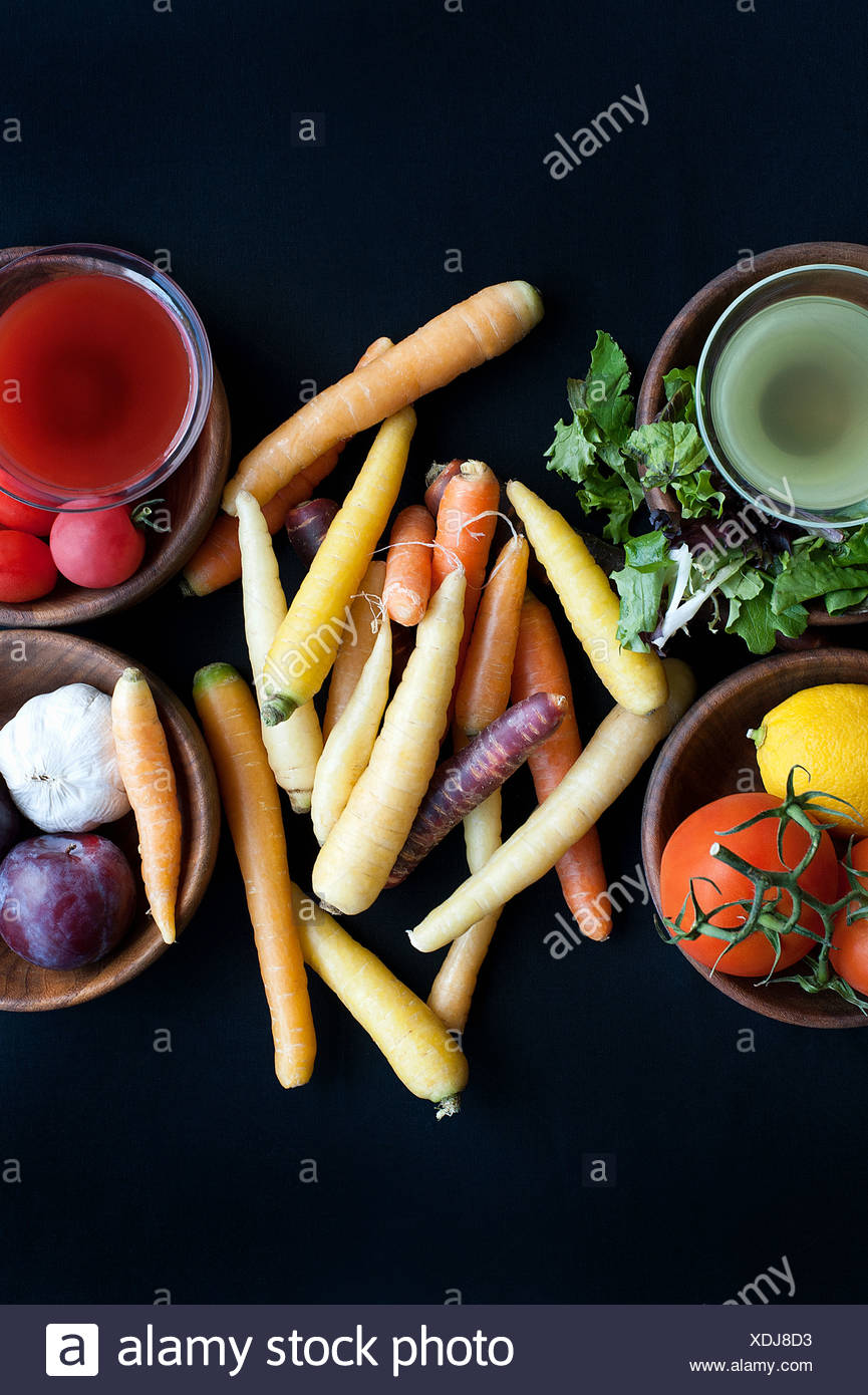 Bowls of vegetables on table - Stock Image