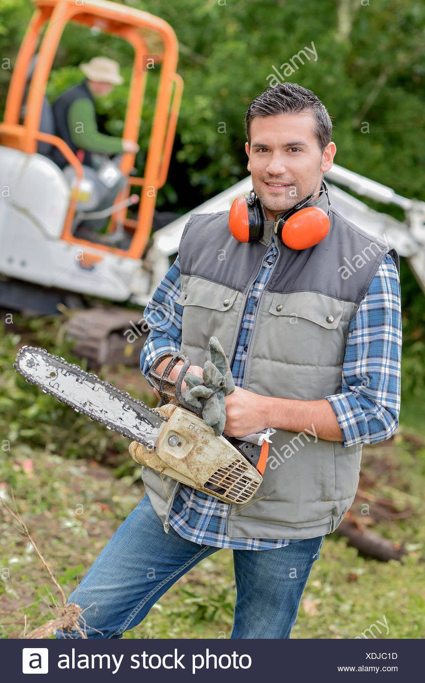 Landscape gardener with a chainsaw Stock Photo