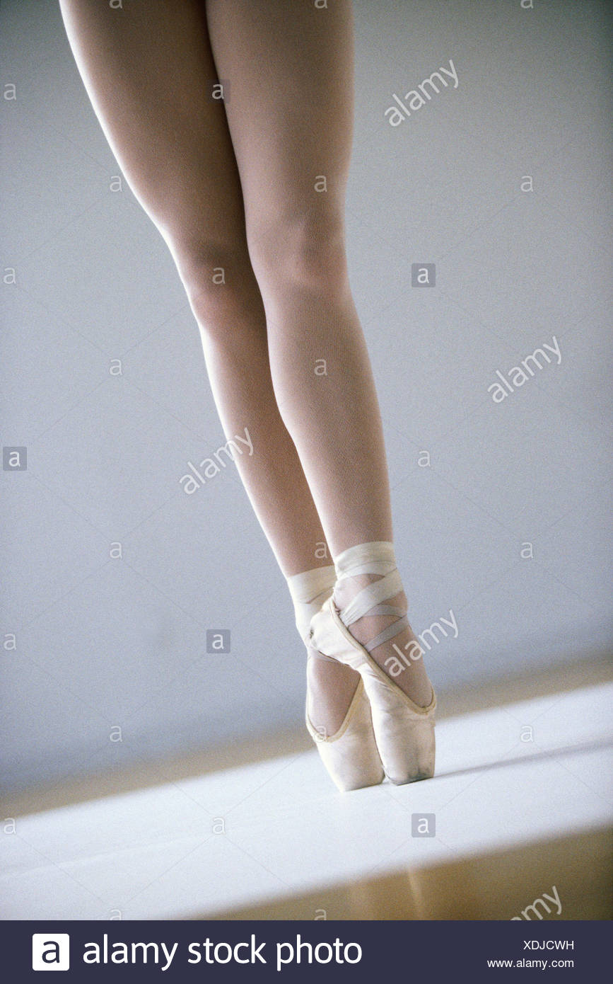 Low section view of a ballerina standing on tiptoe - Stock Image