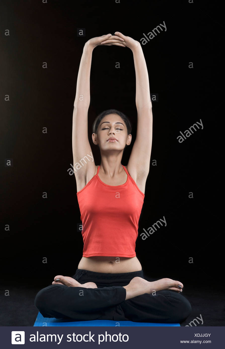 Young woman meditating with her eyes closed - Stock Image