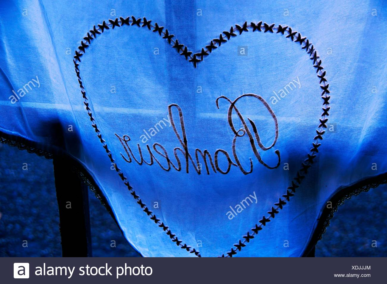 ´Bonheur´ (happiness) on a curtain at Panjas, Gers, Midi-Pyrenees, France - Stock Image