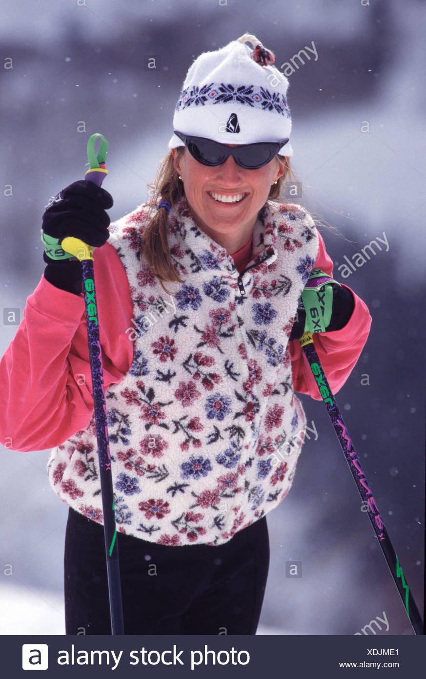 A woman cross country skiing at Sundance UT - Stock Image