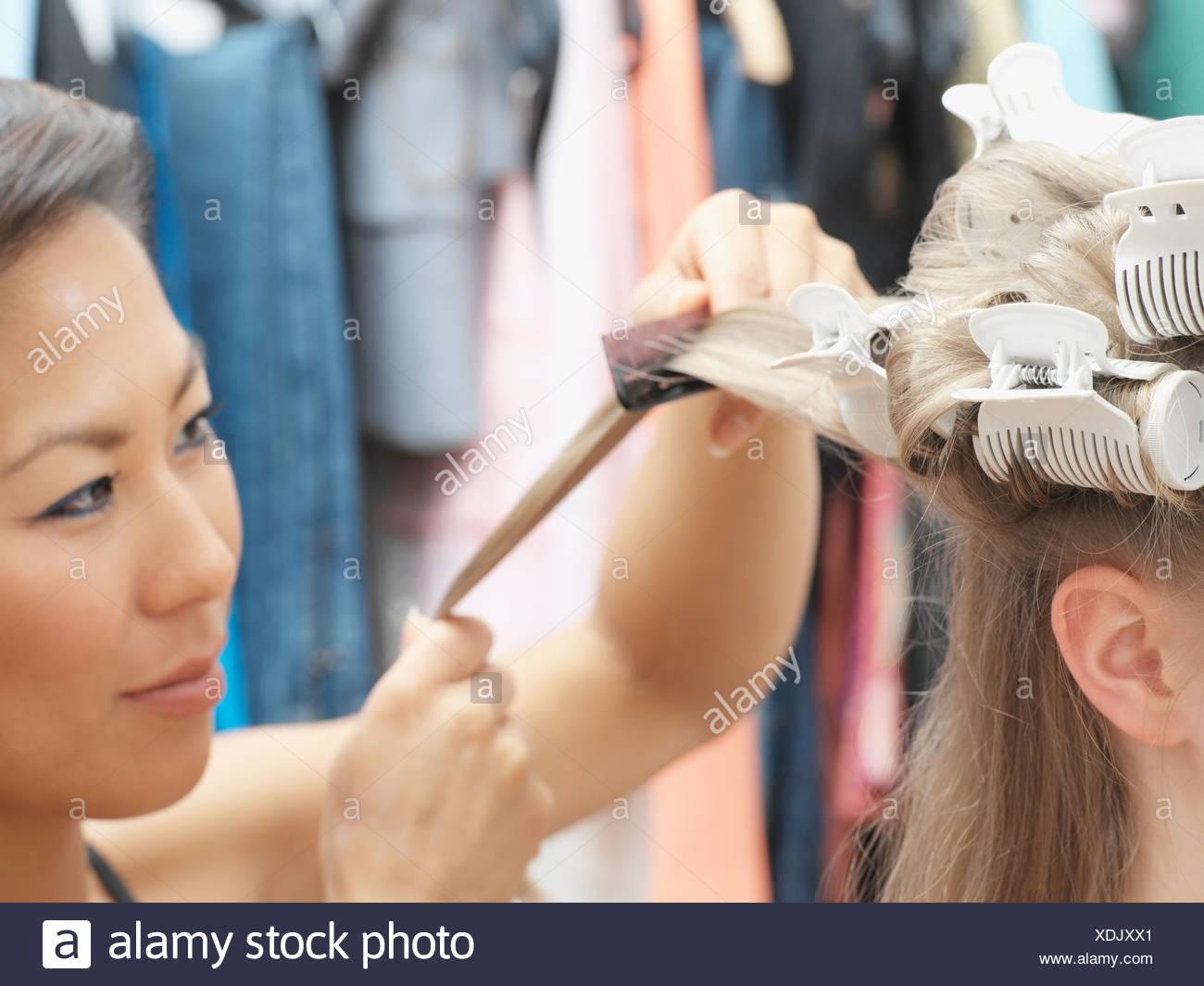 Hairdresser working on model's hair - Stock Image