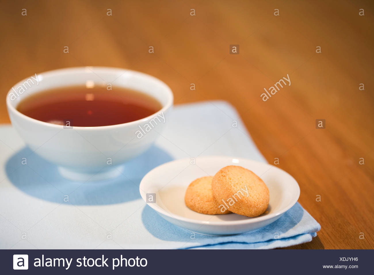 A cup of tea and some cakes - Stock Image