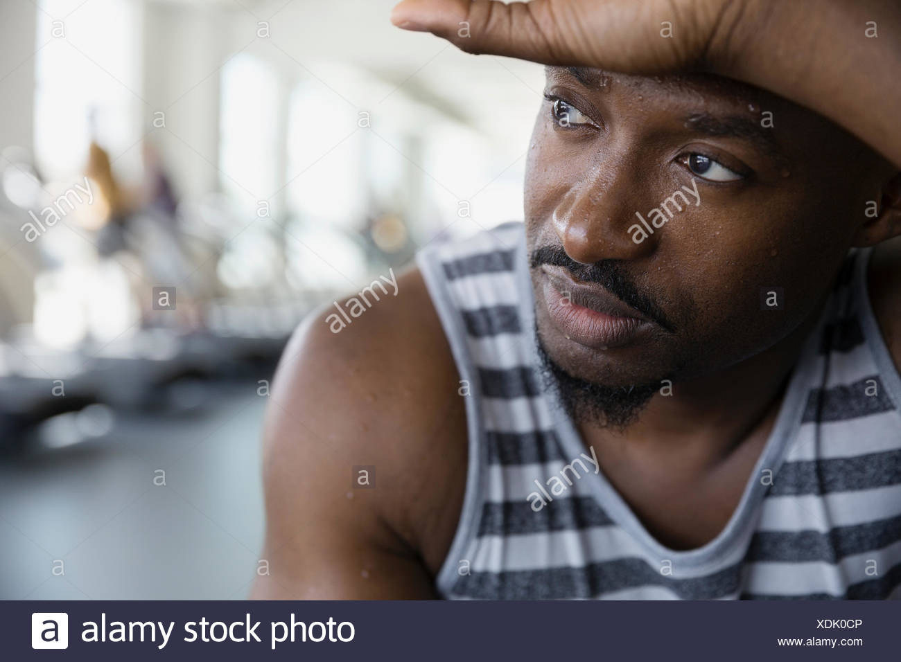 Close up portrait tired man looking away gym - Stock Image