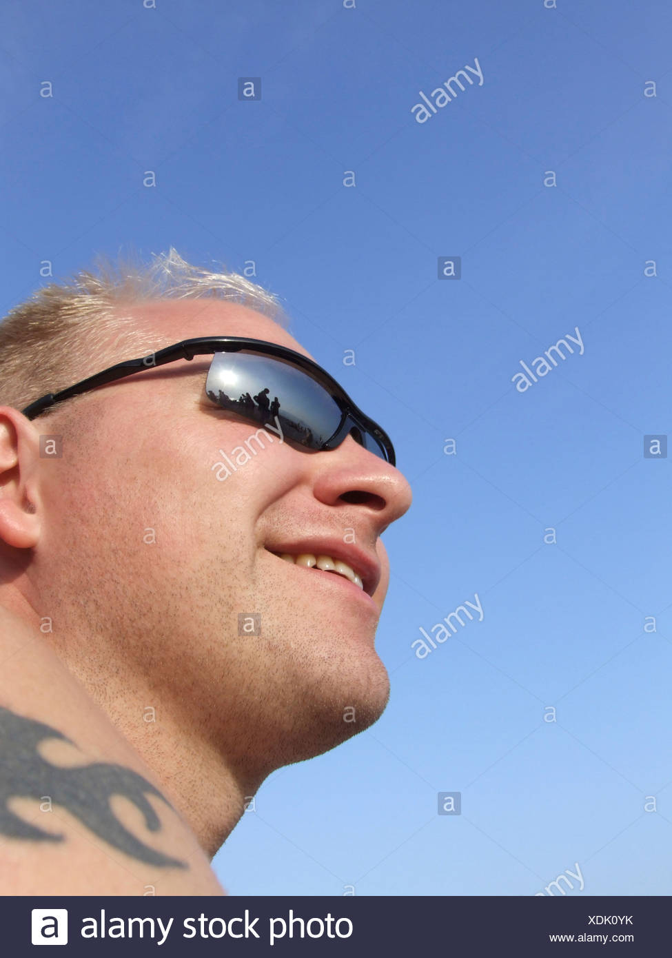 3e9b8a3d8830 Mid adult man wearing sunglasses close up low angle view Stock Photo ...