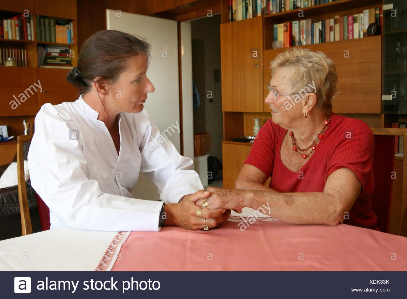 Senior citizen with a nurse - Stock Image