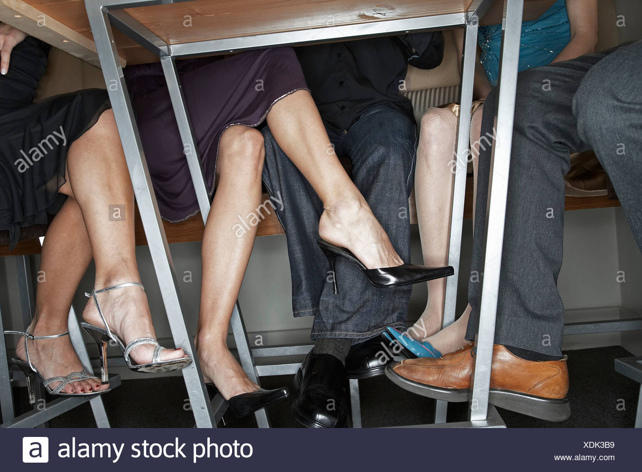 Peoples Legs Under Table Stock Photos Peoples Legs Under Table