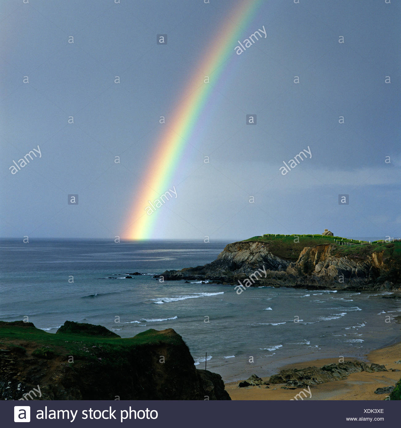Le Pouldu Departement Finistère France rain bow after a thunder storm above the coast of the Atlantic Ocean near the Laita estu - Stock Image