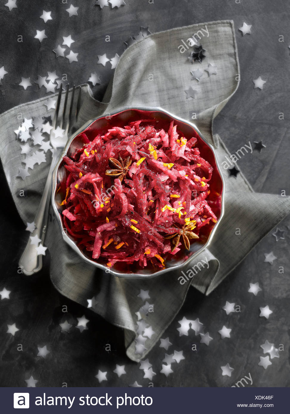 Raw grated beetroot,apple and orange zest salad with aniseed - Stock Image